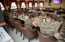 Maj. Edward Banta, commander, Marine Corps Installations Command, shares lunch with Marines assigned to various units within Camp Mujuk in South Korea, July 22, 2019. Banta was visiting Marine Corps Installations throughout the pacific in order to see how day-to-day operations are conducted. (U.S. Marine Corps photo by Lance Cpl. Savannah Mesimer)