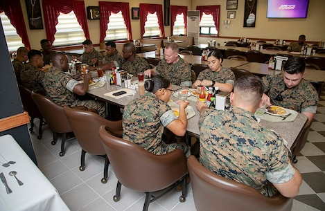 Maj. Gen. Edward Banta, commander, Marine Corps Installations Command, shares lunch with Marines assigned to various units within Camp Mujuk in South Korea, July 22, 2019. Banta was visiting Marine Corps Installations throughout the pacific in order to see how day-to-day operations are conducted. (U.S. Marine Corps photo by Lance Cpl. Savannah Mesimer)