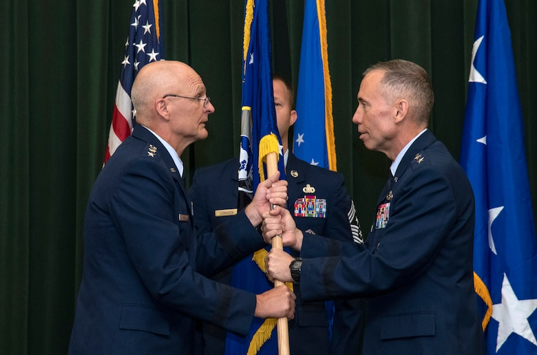 Maj. Gen. Tom Wilcox receives the unit flag from Gen. Arnold W. Bunch Jr., commander of Air Force Materiel Command, to become commander of the Air Force Installation and Mission Support Center July 25 during a ceremony at Joint Base San Antonio-Lackland. (U.S. Air Force photo by Johnny Saldivar)