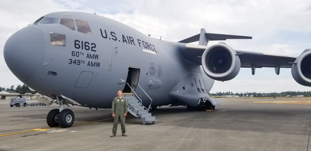 Maj. Dennis Martin, 225th Air Defense Squadron air battle manager, prepares to board a C-17 asssigned to the 60th Air Moblity Wing from Travis Air Force Base, Calif., as part of Exercise Rainier War June 26, 2019 at Joint Base Lewis-McChord.  Martin is one of four air battle managers flying onboard the C-17s during the exercise in order to accomplish a portion of his training requirements to convert to a rated air battle manager.  (Courtesy Photo)