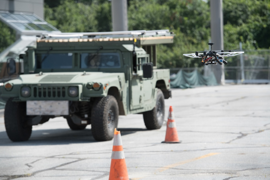 An autonomous drone hovers during the Air Force's Unmanned Aerial Systems Pitch Day, July 24, at the Northeastern University Innovation Campus in Burlington, Mass. The demonstration of autonomous drone technology was part of a day dedicated to bringing new and innovative companies into the Air Force to work on detecting, tracking, defeating and controlling drones and drone swarms. (U.S. Air Force photo by Todd Maki)