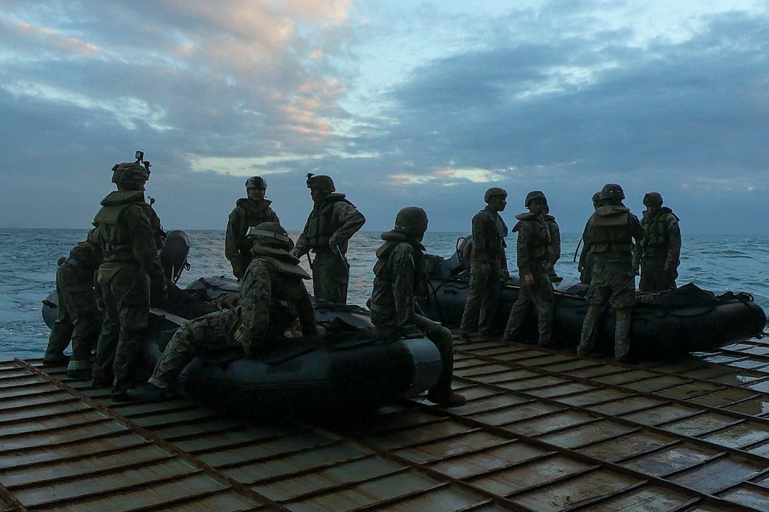 Marines with Battalion Landing Team, 2nd Battalion, 1st Marines, 31st Marine Expeditionary Unit, prepare to launch Combat Rubber Raiding Craft during a boat raid exercise aboard the amphibious dock landing ship USS Ashland, underway in the Coral Sea, July 3, 2019. Ashland, part of the Wasp Amphibious Ready Group, with embarked 31st MEU, is operating in the Indo-Pacific region to enhance interoperability with partners and serve as a ready-response force for any type of contingency, while simultaneously providing a flexible and lethal crisis response force ready to perform a wide range of military operations.