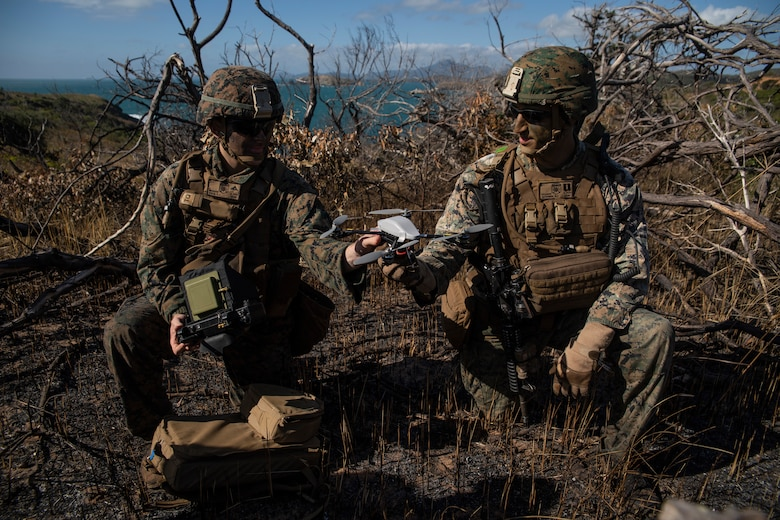Lance Cpl. Kaleb J. Kolb (left), an intelligence Marine, and Capt. Benjamin F. Sutphen (right), Golf Company Commander, both with Battalion Landing Team, 2nd Battalion, 1st Marines, 31st Marine Expeditionary Unit, prepare to launch an Instanteye MK-2 GEN3-A0 drone during a boat raid exercise on Townshend Island, Shoalwater Bay Training Area, Queensland, Australia, July 3, 2019. The 31st Marine Expeditionary Unit, the Marine Corps' only continuously forward-deployed MEU, provides a flexible and lethal force ready to perform a wide range of military operations as the premier crisis response force in the Indo-Pacific region.