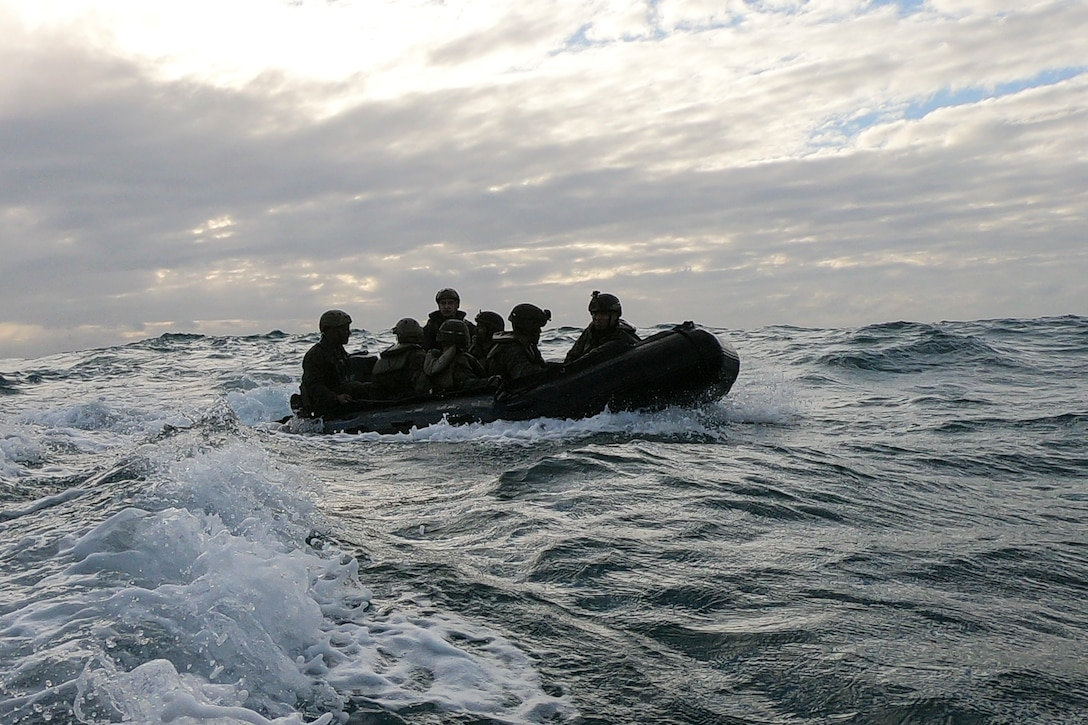 Marines with Battalion Landing Team, 2nd Battalion, 1st Marines, 31st Marine Expeditionary Unit, ride ashore in a Combat Rubber Raiding Craft during a boat raid exercise in the Coral Sea, July 3, 2019. The Marines launched from the amphibious dock landing ship USS Ashland, part of the Wasp Amphibious Ready Group, with embarked 31st MEU, while operating in the Indo-Pacific region to enhance interoperability with partners and serve as a ready-response force for any type of contingency, while simultaneously providing a flexible and lethal crisis response force ready to perform a wide range of military operations.
