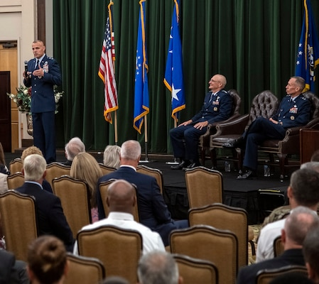 Maj. Gen. Brad Spacy (left), outgoing Air Force Installation and Mission Support Center commander, addresses the audience during the AFIMSC change of command July 25 at Joint Base San Antonio-Lackland. The general is retiring after 32 years of service.