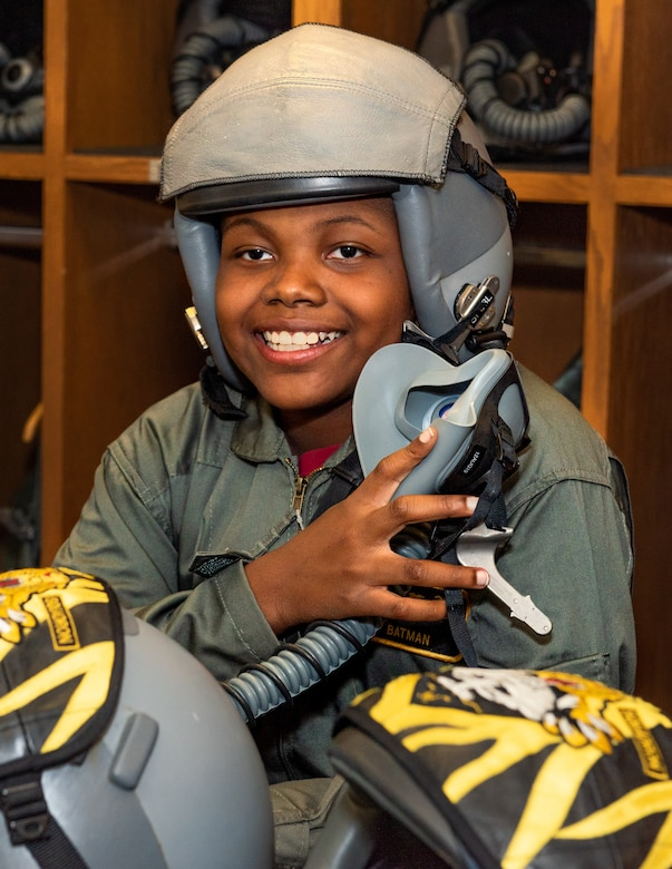 "Emil ""Batman"" Conley from Lee Summit, poses for a photo before an oxygen mask demonstration at the 509th Operations Support Squadron during his Pilot for a Day tour on July 19, 2019, at Whiteman Air Force Base, Missouri. Emil has medulloblastoma, which is the most common malignant brain tumor for children, and accounts for about 20 percent of all childhood brain tumors. Medulloblastoma can be treated with surgery, radiation therapy, as well as chemotherapy. Whiteman AFB collaborates with St. Jude Children's Research Hospital to coordinate these tours. (U.S. Air Force photo by Senior Airman Thomas Barley)"