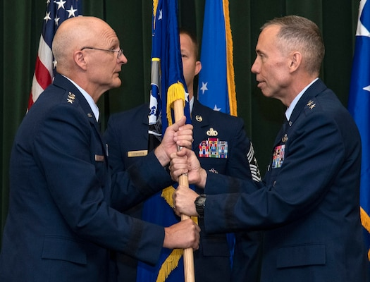 Maj. Gen. Tom Wilcox (right) receives the unit flag from Gen. Arnold W. Bunch Jr., commander of Air Force Materiel Command, to become commander of the Air Force Installation and Mission Support Center July 25 during a ceremony at Joint Base San Antonio-Lackland.