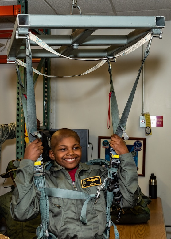 "Emil ""Batman"" Conley from Lee Summit, Missouri, tests the egress system during his Pilot for a Day tour on July 19, 2019, at Whiteman Air Force Base, Missouri. Aircrew Flight Equipment specialist perform maintenance and coordination of seats, hatches, canopies and modules, to ensure that pilots can make a safe escape in case of emergency. Emil has medulloblastoma, which is the most common malignant brain tumor for children, and accounts for about 20 percent of all childhood brain tumors. Whiteman AFB collaborates with St. Jude Children's Research Hospital to coordinate these tours. (U.S. Air Force photo by Senior Airman Thomas Barley)"
