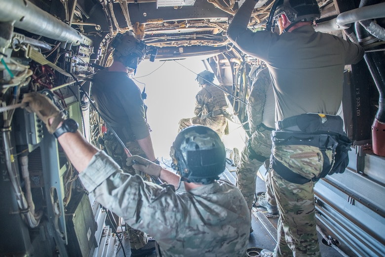 Pararescuemen from the 26th Special Tactics Squadron fly in a CV-22 Osprey to over New Mexico July 23, 2019. The members practiced water-based aerial extraction at Ute Lake with members of the 20th Special Operations Squadron. (U.S. Air Force photo by Senior Airman Vernon R. Walter III)