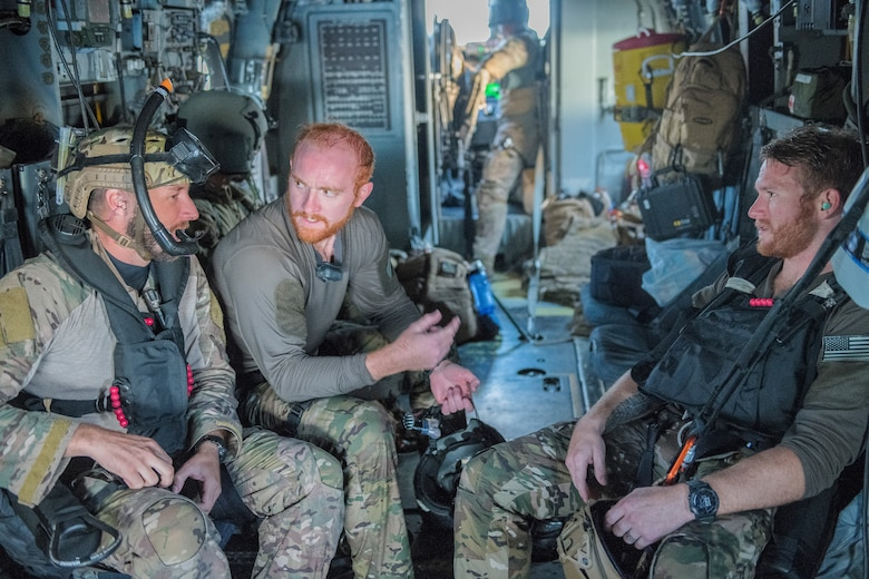 Pararescuemen from the 26th Special Tactics Squadron speak amongst themselves after a training exercise at Ute Lake, N.M., July 23, 2019. The members performed training during the day and night, to test their rescue capabilities under different environmental circumstances. (U.S. Air Force photo by Senior Airman Vernon R. Walter III)