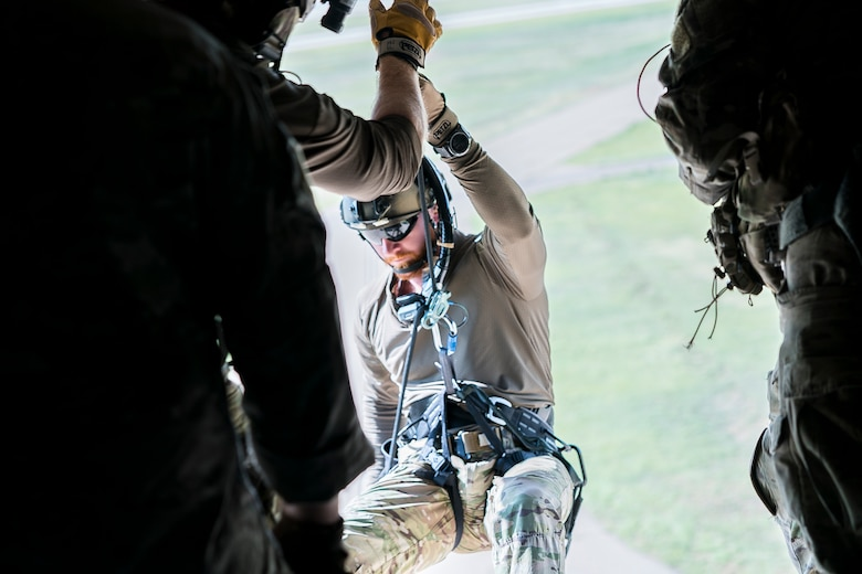 Staff Sgt. Joe, 26th Special Tactics Squadron pararescuman, rappels from a CV-22 Osprey with the 20th Special Operations Squadron at Cannon Air Force Base, N.M., July 23, 2019. The training tested the air-to-land capabilities of the pararescuemen. (U.S. Air Force photo by Senior Airman Vernon R. Walter III)