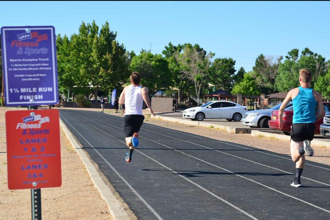 Participants in the Fastest Athletes on Base Track Meet sprint to the finish line.