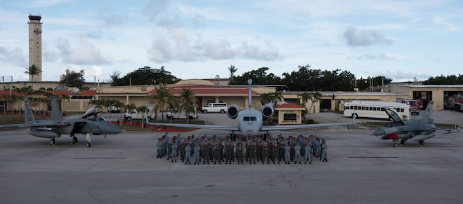 Republic of Singapore Air Force personnel stand in front of (from left to right) an F-15C Eagle from the 122nd Fighter Squadron from the 159th Fighter Wing of the New Orleans Air National Guard, Louisiana, and an RSAF G550 Airborne Early Warning aircraft and an RSAF F-16 at Andersen Air Force Base, Guam, July 9, 2019.