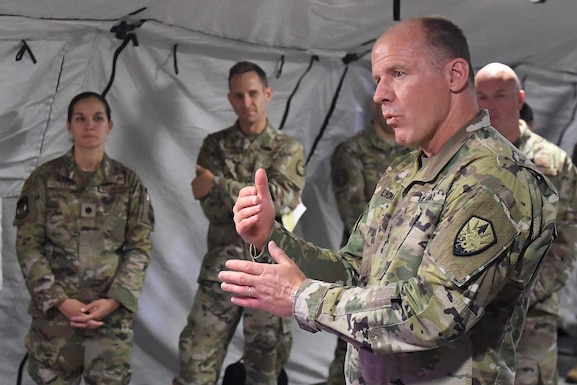 Army General Stephen Lyons, commander of U.S. Transportation Command, right, speaks with Airmen from the 621st Contingency Response Wing, July 24, 2019, at Travis Air Force Base, Calif. During the visit, contingency response Airmen showcased their capabilities and discussed how the wing supports USTRANSCOM's full-spectrum requirements in support of national objectives. The CRW supports four key mission areas, which include air advisors, joint mobility operations, theater-wide command and control, and the ability to generate airfields on demand in any environment. (U.S. Air Force by Tech. Sgt. Liliana Moreno)
