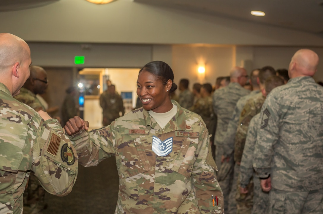 Technical Sgt. Alexis Brunson is congratulated¬ by a fellow Airman during a technical sergeant release party at Edwards Air Force Base, July 18. (U.S. Air Force photo by Richard Gonzales)