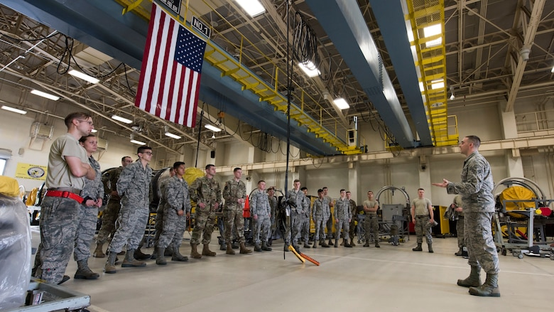 U.S. Air Force Senior Airman Taylor Reineke, a 35th Maintenance Squadron aerospace propulsions journeyman, speaks with his fellow wingmen on operational safety and rules at Misawa Air Base, Japan, July 16, 2019. The shop implemented continuous process improvements, such as a new storage facility, to maximize daily operation capabilities by providing space, storage and convenience needed. This aided in a team best of engines serviced in a month since 2006. (U.S. Air Force photo by Senior Airman Collette Brooks)