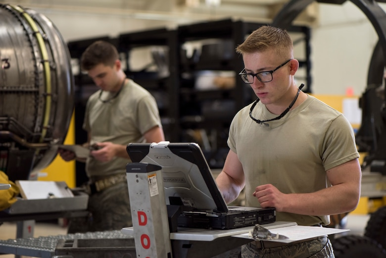 U.S. Air Force Airman Ryan Voss, a 35th Maintenance Squadron aerospace propulsion journeyman, works on a computer at Misawa Air Base, Japan, July 16, 2019. A newly opened storage facility, dedication and work ethic allowed the 35th MXS propulsions centralized repair team to produce a record breaking amount of serviced engines in a month since 2006. (U.S. Air Force photo by Senior Airman Collette Brooks)