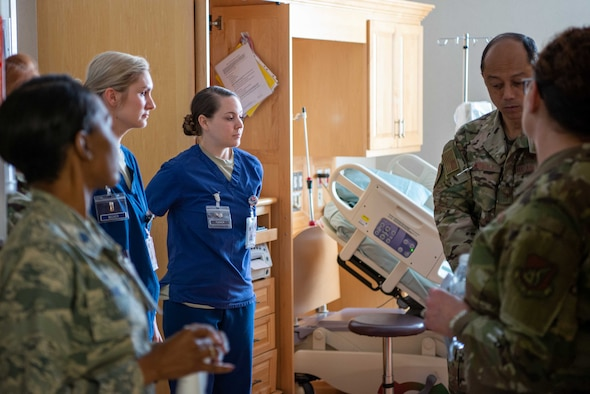 Col. Rudolph Cachuela, Pacific Air Forces Command Surgeon, receives a tour of the Multi Service Inpatient Unit  from members of the 374th Medical Group at Yokota AB, Japan, July 23, 2019. Cachuela visited the 374th Medical Group to better understand how his team can increase the effectiveness of the medical personnel at Yokota.