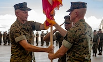 U.S. Marine Corps Brig. Gen. William J. Bowers receives the Marine Corps colors from Maj. Gen. Paul Rock Jr. at Marine Corps Air Station Futenma, July 26, 2019 signifying the passing of command for Marine Corps Installations Pacific – Marine Corps Base Camp Smedley D. Butler.