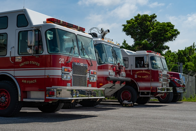 Fire department vehicles assigned to the 18th Civil Engineer Squadron standby on a safe site near a simulated chemical spill during a hazardous material training exercise July 11, 2019, on Kadena Air Base, Japan. The main objective of the HazMat training is for firefighters to familiarize themselves with hazardous materials and prevent them from spreading. (U.S. Air Force photo by Senior Airman Cynthia Belío)