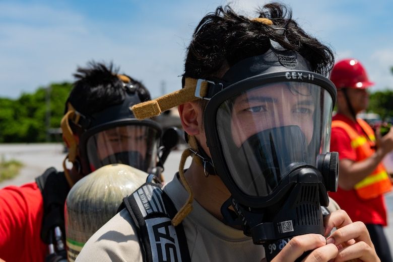 U.S. Air Force Senior Airman Sean Kientz, emergency management journeyman assigned to the 18th Civil Engineer Squadron, tests a self-contained breathing apparatus during a hazardous material training exercise July 11, 2019, on Kadena Air Base, Japan. The Level A suit worn during this training provides the highest level of protection against direct and airborne chemical contact, and is often worn with a self-contained breathing apparatus. (U.S. Air Force photo by Senior Airman Cynthia Belío)
