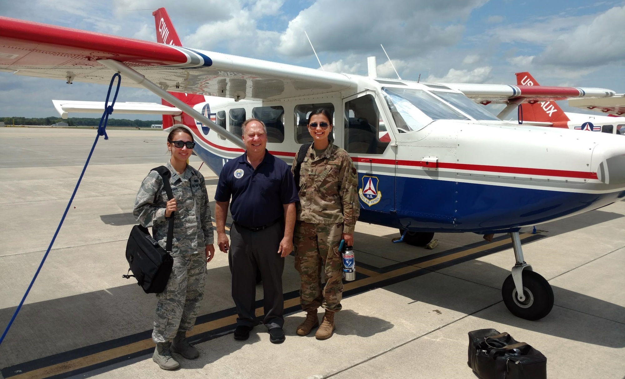 Lt. Col. Ken Curell (center) of CAP's Ohio Wing is flanked by two Pilot Prep Program students – Air Force 1st Lts. Sherry Meadows, assigned to Aviano Air Base, Italy, and Makenna Elliott, assigned to Offutt Air Force Base, Neb. (Civil Air Patrol photo by Ron Olienyk)