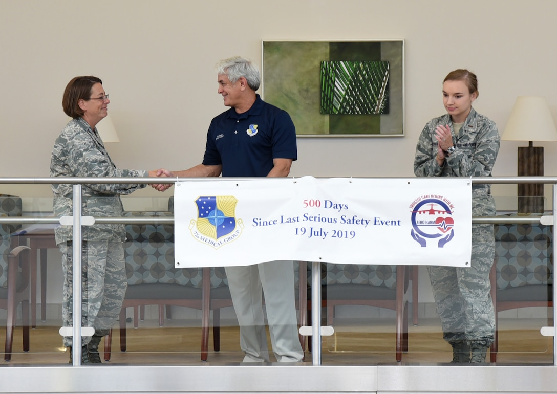 72nd Medical Group Commander, Col. Jennifer L. Trinkle, officiated a ceremony commemorating milestone days without a Serious Safety Event. The 500 days banner was unfurled by Bob Sandlin, 72nd Air Base Wing director of staff and Lt. Madison Rauenbuehler, 72nd Medical Group Medical Readiness flight commander. (U.S. Air Force photos/Kelly White)