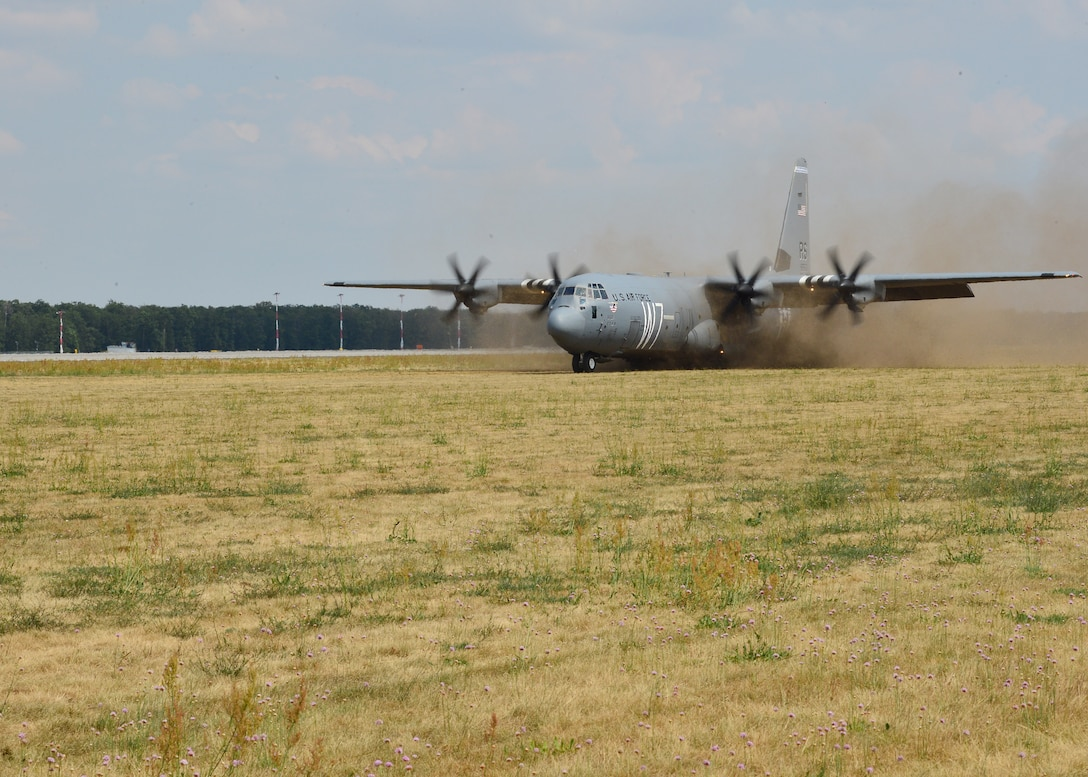 A U.S. Air Force C-130J Super Hercules assigned to the 37th Airlift Squadron lands on a grass landing zone at Powidz Air Base, Poland, July 20, 2019. Pilots were able to practice landing on unpaved surfaces to improve their capabilities and readiness. (U.S. Air Force photo by Staff Sgt. Jimmie D. Pike)