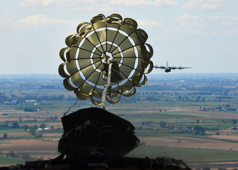 A parachute deploys from an airdrop platform during an Aviation Rotation 19-3 training flight over Powidz Air Base, Poland, July 18, 2019. Aircrew members performed low-cost low-altitude, container delivery system, and heavy equipment air drops to maintain operation proficiency. (U.S. Air Force photo by Staff Sgt. Jimmie D. Pike)