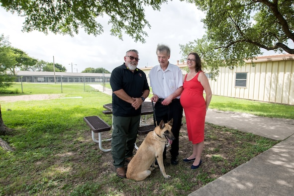 Jerry Britt (left), 341st Training Squadron adoptions and dispositions coordinator, professor Robert Klesges, and Melissa Little, 59th Medical Wing behavioral health preventive medicine researcher, pose for a photo with a military working dog (MWD) June 26, 2019, at Joint Base San Antonio, Texas