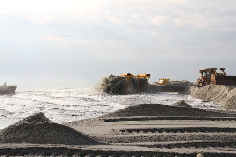 In 2013, USACE completed periodic nourishment of the Cape May to Lower Township project. Sand is pumped through a basket on the beach as part of a screening system.