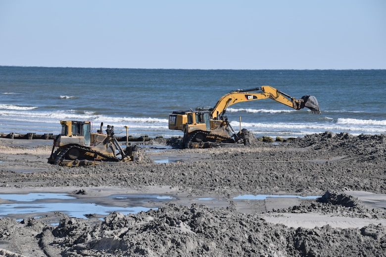 Construction equipment pushes sand into an engineered beach template as part of the 2017 periodic nourishment of the Cape May to Lower Township project.