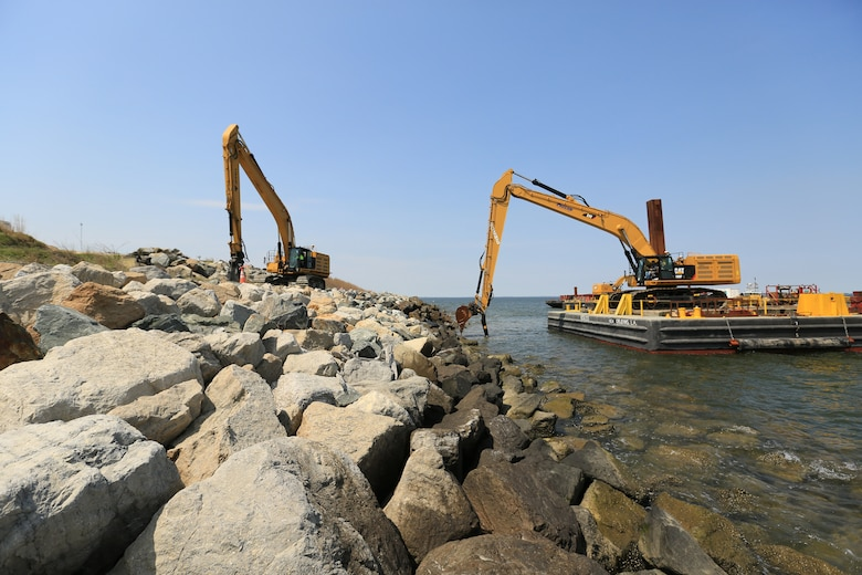 Large rocks are placed at the expansion site in April 2016 to armor dikes that will eventually contain dredged material from the approach channels to the Port of Baltimore.