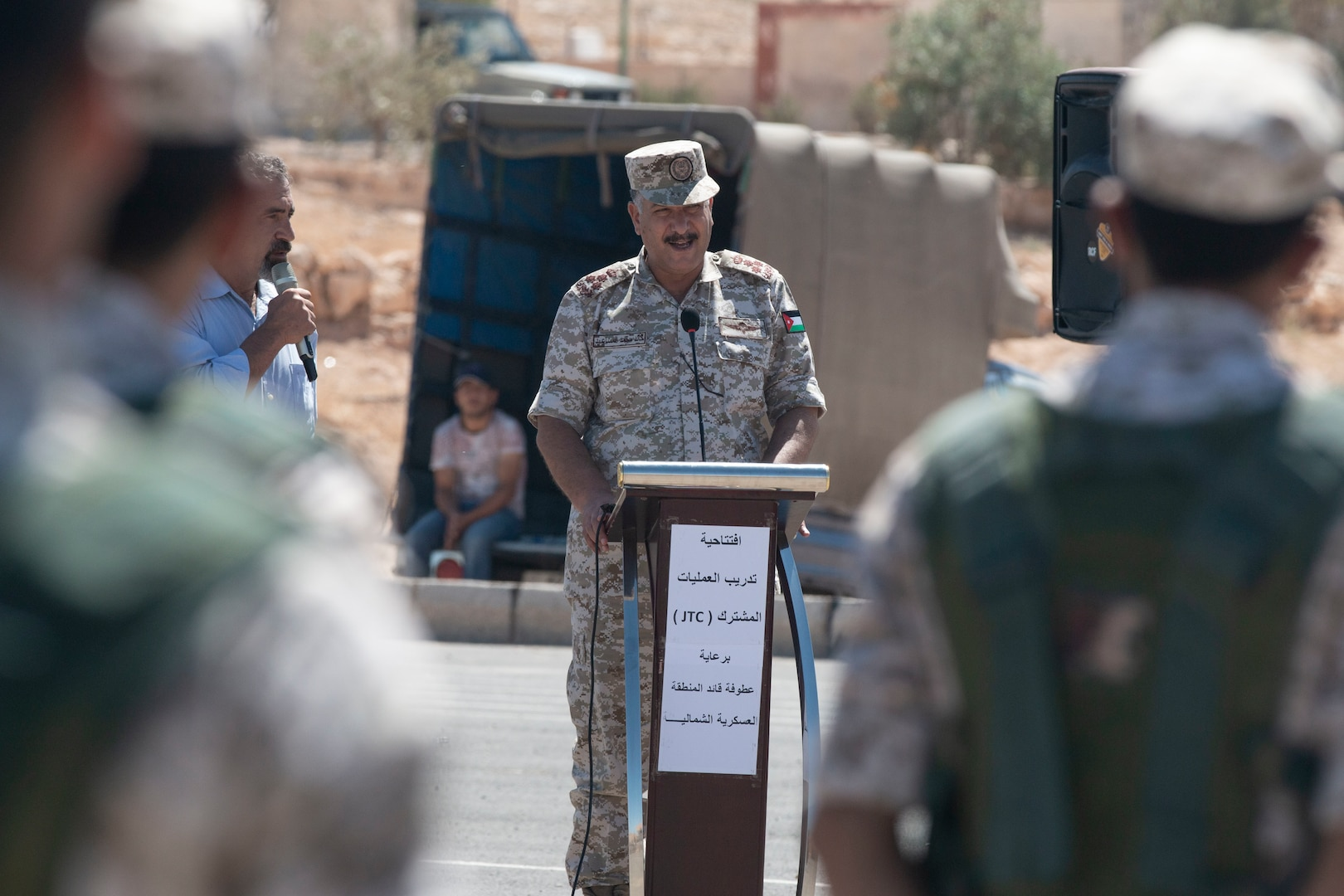 Jordan Armed Forces Brig. Gen. Khalid Al-Masaeid, Northern region commander, speaks to New Jersey National Guard Soldiers, with 1st Squadron, 102nd Calvary Regiment, and Jordan Border Guard Force Soldiers, with the 7th Mechanized Battalion, 48th Mechanized Brigade, during the Jordan Operational Engagement Program (JOEP) opening ceremony July 14, 2019. JOEP is a 14-week individual and collective training, as well as a military partnership between Jordan and America.