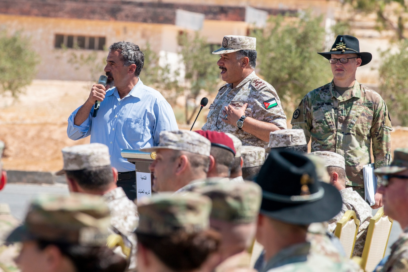 Jordan Armed Forces Brig. Gen. Khalid Al-Masaeid (center), Northern region commander, speaks to New Jersey National Guard Soldiers, with 1st Squadron, 102nd Calvary Regiment, and Jordan Border Guard Force Soldiers, with the 7th Mechanized Battalion, 48th Mechanized Brigade, during the Jordan Operational Engagement Program (JOEP) opening ceremony July 14, 2019. JOEP is a 14-week individual and collective training, as well as a military partnership between Jordan and America.