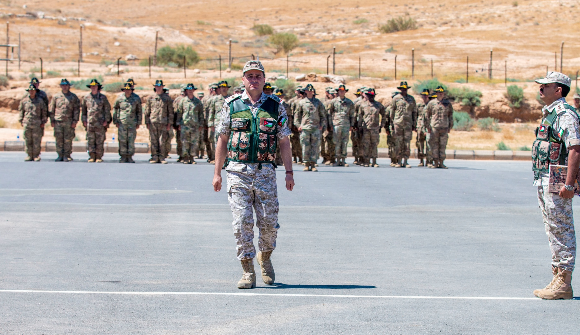New Jersey National Guard Soldiers, with 1st Squadron, 102nd Calvary Regiment, and Jordan Border Guard Force Soldiers, with the 7th Mechanized Battalion, 48th Mechanized Brigade, participate in the Jordan Operational Engagement Program (JOEP) opening ceremony July 14, 2019. JOEP is a 14-week individual and collective training, as well as a military partnership between Jordan and America.