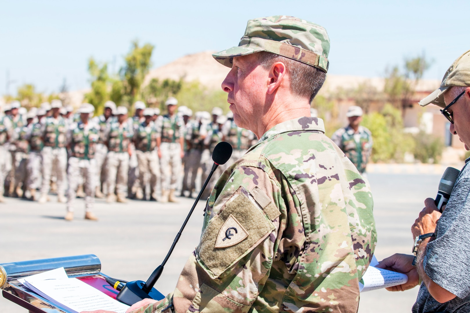 U.S. Army Col. Kirk White, senior Army leader of Jordan, speaks to New Jersey National Guard Soldiers, with 1st Squadron, 102nd Calvary Regiment, and Jordan Border Guard Force Soldiers, with the 7th Mechanized Battalion, 48th Mechanized Brigade, on behalf of Task Force Spartan-Jordan at the Jordan Operational Engagement Program (JOEP) opening ceremony July 14, 2019. JOEP is a 14-week individual and collective training, as well as a military partnership between Jordan and America.
