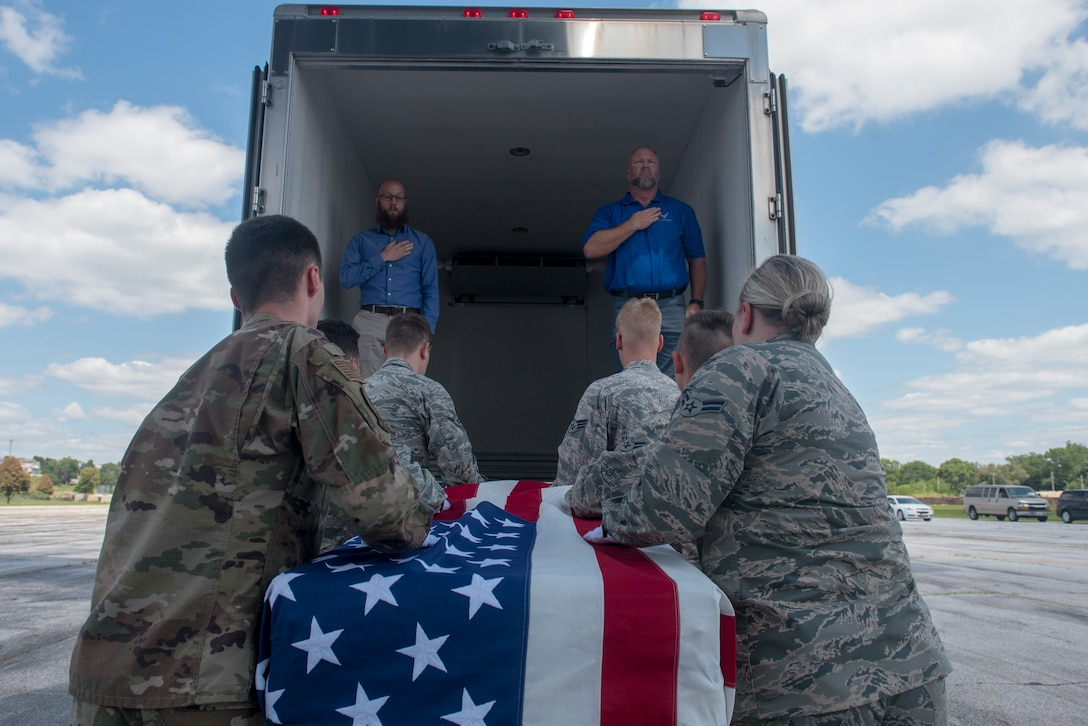 A team of Offutt Honor Guardsmen load a casket containing the remains of a World War II service member onto a truck for transportation to the Defense POW/MIA Accounting Agency here during a dignified transfer July 23, 2019. For additional images of the transfer, visit https://www.flickr.com/photos/offutt_afb/albums/72157709886860852
