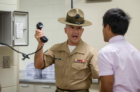 The new recruits make a scripted phone call home to inform their next of kin that they have arrived safely at Parris Island, S.C. The receiving process includes the recruit's phone call home, gear issue, and haircuts. (U.S. Marine Corps photo by Pfc. Michelle Brudnicki)