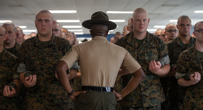 Senior Drill Instructor Staff Sgt. Keon Pondexter, 3rd Recruit Training Battalion, commands his recruits on Marine Corps Recruit Depot Parris Island, S.C. July 19, 2019. The formation Pondexter is putting the recruits in is how they will line up every time he has a mentoring session with them. (U.S. Marine Corps photo by Pfc. Michelle Brudnicki)