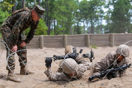 Staff Sgt. Jake Bohan, a drill instructor with Fox Company, 2nd Recruit Training Battalion motivates recruits as they make their way through the Day Movement Course July 19, 2019 at Marine Corps Recruit Depot Parris Island. The Day Movement course tests recruits ability to maneuver as a fireteam under simulated combat conditions.
