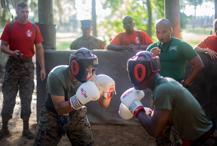 Recruits with Delta Company, 1st Recruit Training Battalion, practice the fundamentals of body sparring on Marine Corps Recruit Depot Parris Island, S.C., July 25, 2019. Body sparring is an exercise that exemplifies the fundamentals of Marine Corps Martial Arts and forces recruits to overcome physical and mental fatigue. (U.S. Marine Corps photo by Lance Cpl. Dylan Walters)