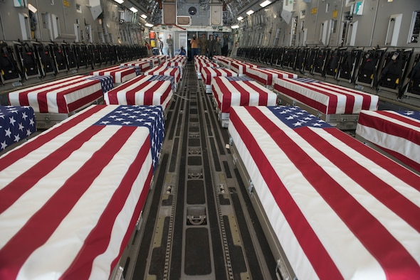 Caskets containing the remains of 28 World War II soldiers sit in the back of a C-17 Globemaster III during a dignified transfer July 23, 2019. For additional images of the transfer, visit https://www.flickr.com/photos/offutt_afb/albums/72157709886860852