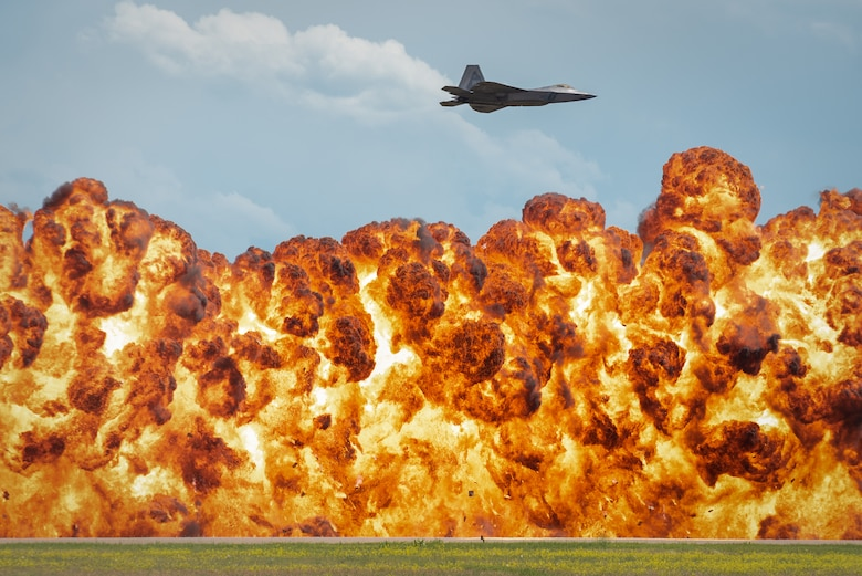 1,000-foot wall of fire explodes below the F-22 Raptor