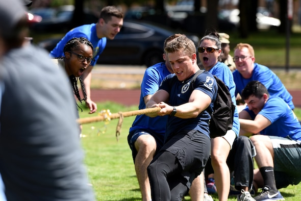U.S. Airmen assigned to the 48th Mission Support Group participate in tug of war during the 48th MSG Olympics at Royal Air Force Lakenheath, England, July 22, 2019. Airmen and their families enjoyed food, music and resiliency events, such as ultimate frisbee and tug of war.  (U.S. Air Force photo by Airman 1st Class Madeline Herzog)