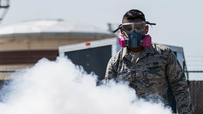 Airman 1st Class Alberto Montesino, a 2nd Civil Engineer Squadron pest management apprentice, deploys a mosquito fogger at Barksdale Air Force Base, June 25, 2019. The 2nd CES pest management shop regularly uses the fogger for mosquitoes, as well as tests for mosquito-borne diseases such as the West Nile virus and the Zika virus. (U.S. Air Force photo by Airman Jacob B. Wrightsman)