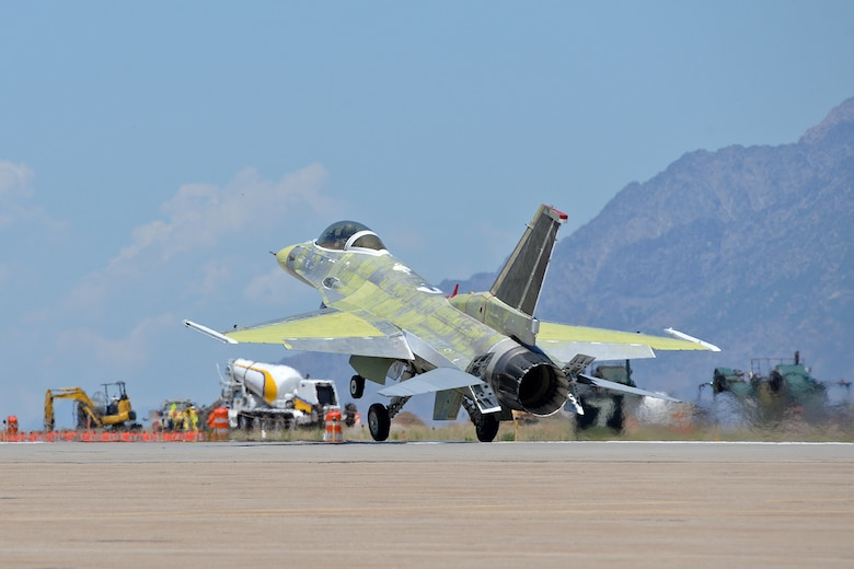 """Lt. Col. Beau """"Strap"""" Wilkins, 514th Flight Test Squadron test pilot, finishes his landing rollout on taxiway Alpha in an unpainted U.S. Air Force Thunderbird F-16 Fighting Falcon at the end of a functional check flight at Hill Air Force Base, Utah, July 1, 2019. (U.S. Air Force photo by Alex R. Lloyd)"""