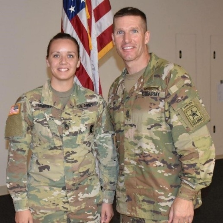 Staff Sgt. Ashley Munger won the 2018 AUSA AGR Recruiter of the Year for the U.S. Army Indianapolis Recruiting Battalion, posed with Sergeant Major of the Army Daniel Dailey at the Association of the United States Army annual meeting in Washington, D.C.