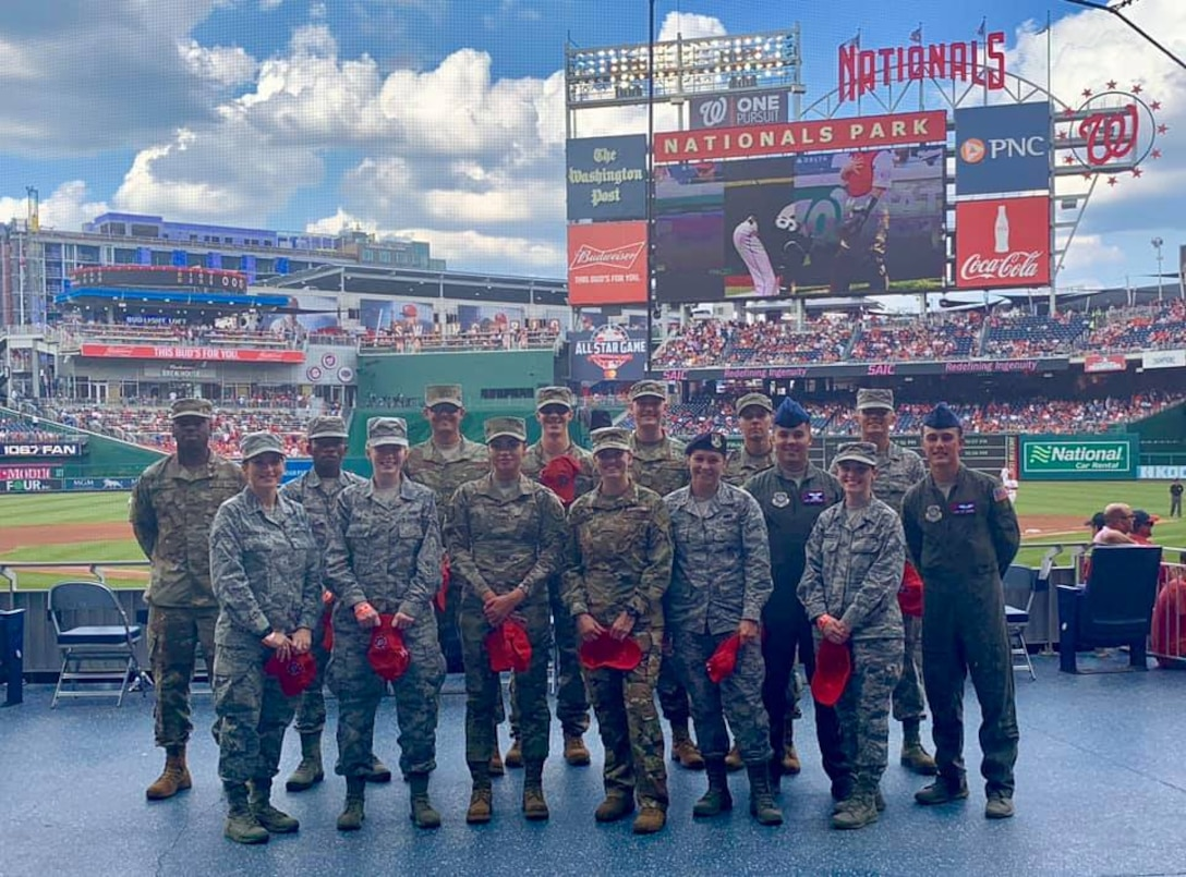 Air Force District of Washington Airmen pose for a photo in front of the Delta Sky360 Club as part of the Salute to Service event July 25. The Washington Nationals offer year-round experiences as thanks and quality-of-life outreach for service members and their families in the Washington region. Around the third inning, honorees are recognized on the NatsHD scoreboard and receive a standing ovation from fans. The Colorado Rockies defeated the Nats 8-7. The next Salute to Service event takes place Aug. 13 against the Cincinnati Reds.