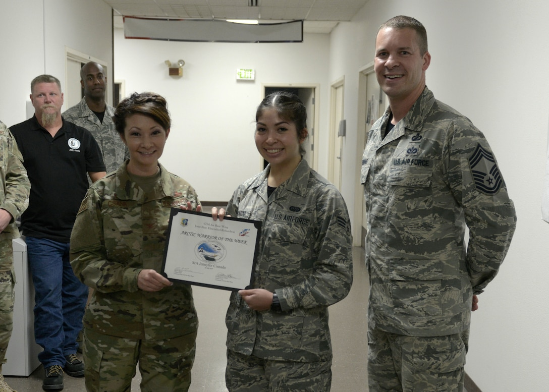 U.S. Air Force Senior Airman Jennyfer Cisnado, 673d Communications Squadron cyber transport technician, is recognized as the Arctic Warrior of the Week at Joint Base Elmendorf-Richardson, Alaska, July 26, 2019.